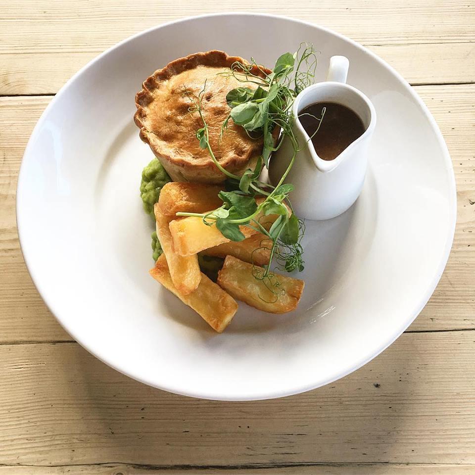 National Pie Week.Home-made Wild Sussex Venison Pie, Mushy Peas, Chips & Gravy